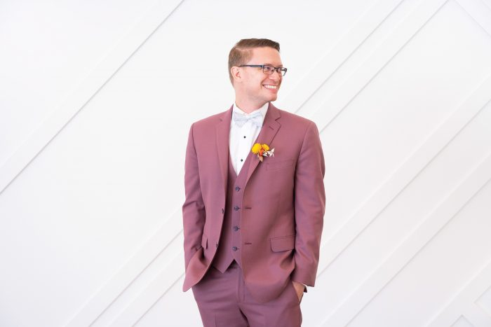 Groom Wearing Purple Suit with Yellow Boutonniere at Citrus Wedding