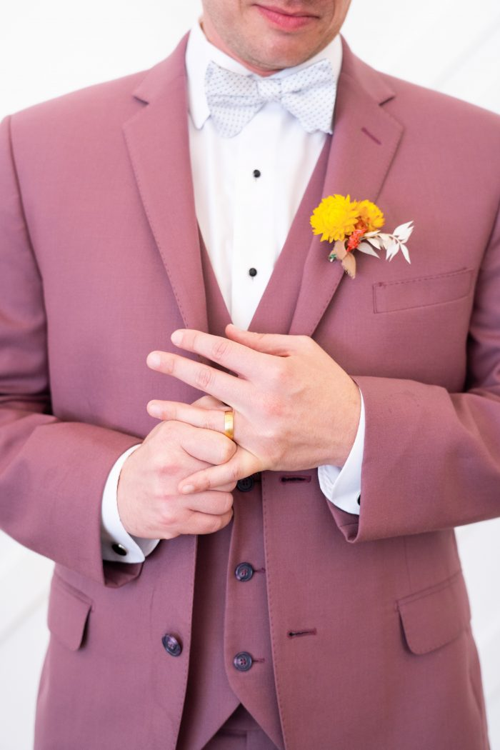 Yellow Boutonniere and Burgundy Suit for Groom's Attire for a Citrus Wedding