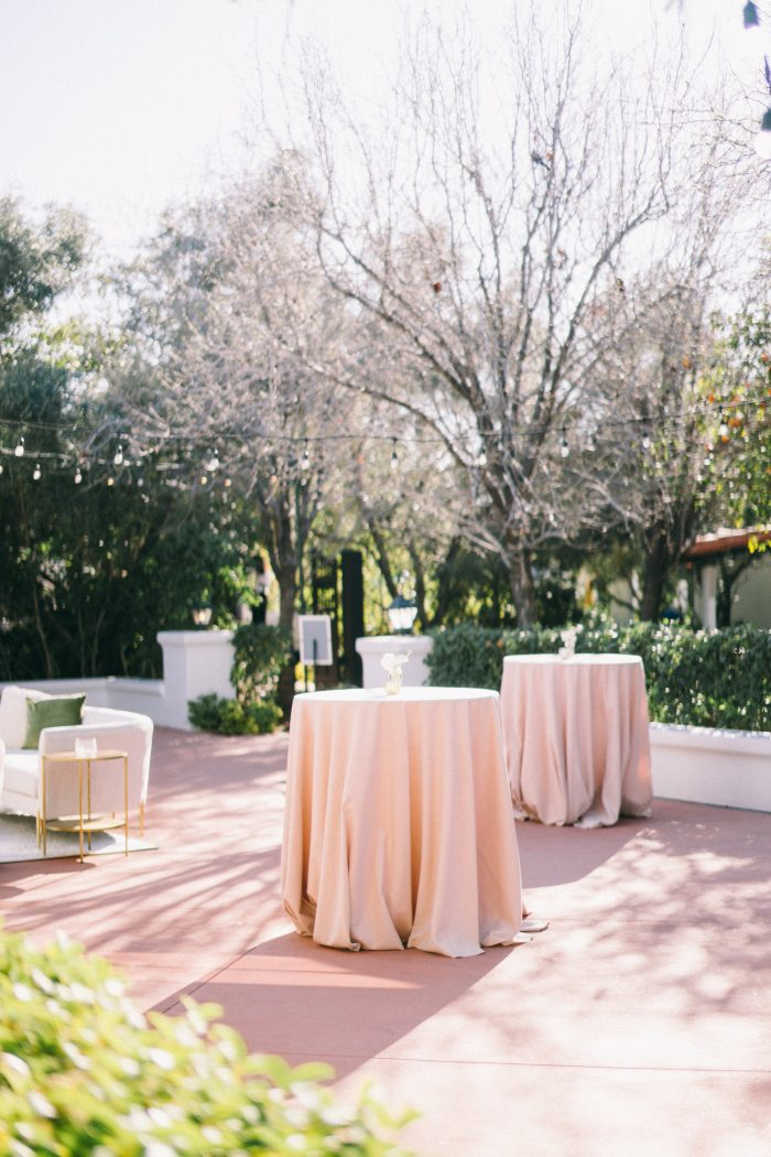 Outdoor Tables with Pink Table Cloths at Wedding Reception