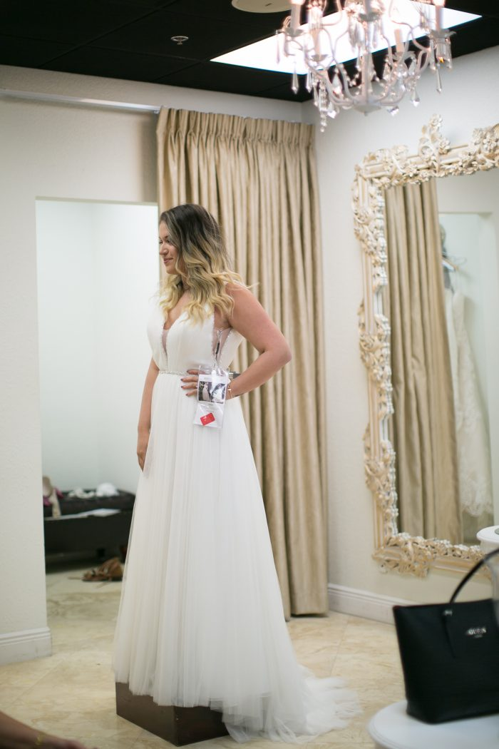 Bride Trying on Wedding Gowns While Wedding Dress Shopping for a Maggie Sottero Wedding Dress