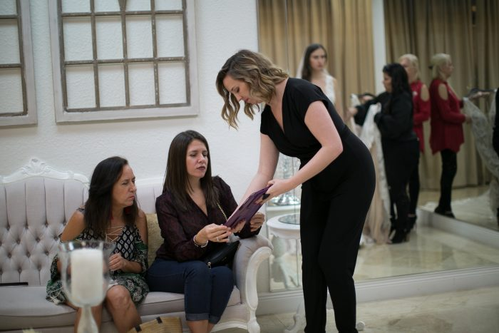 Bridal Consultant Helping Bride Shopping for Her Wedding Dress