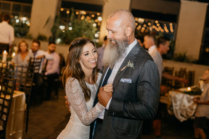 Father of the Bride Wearing Grey Pin Stripe Suit and Dancing with Bride Wearing Maggie Sottero Wedding Dress