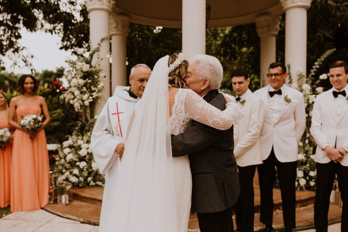 Father of the Bride Kissing Bride at Wedding Ceremony