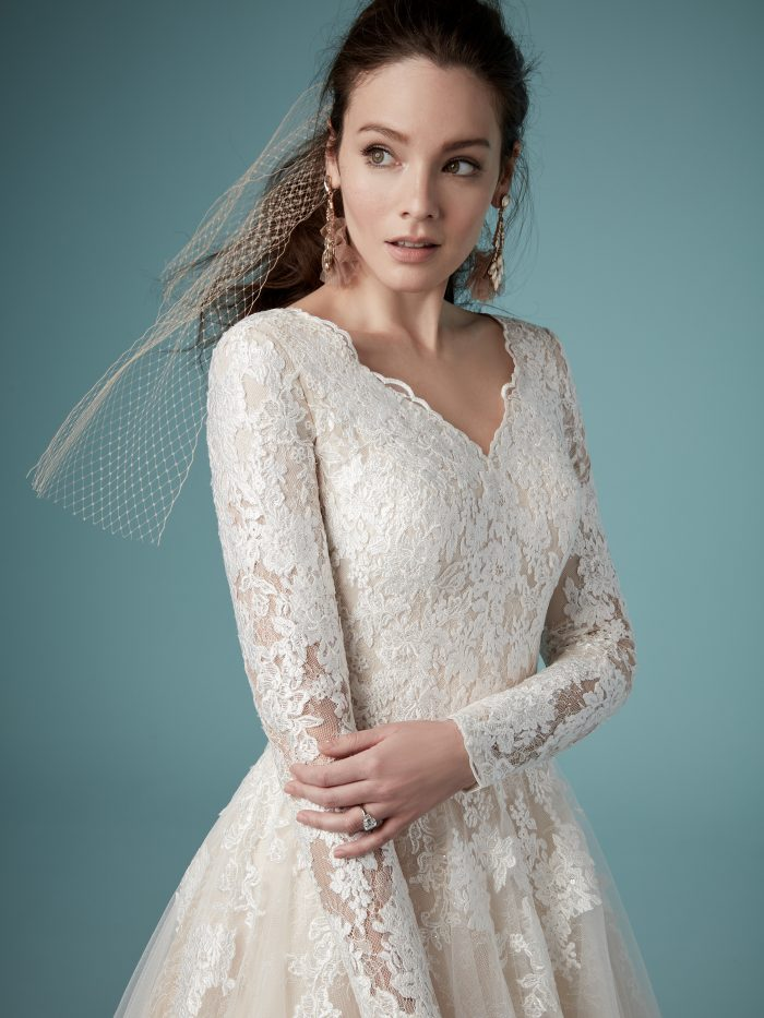 Model Wearing Unique Modest A-line Wedding Gown called Shiloh Leigh by Maggie Sottero