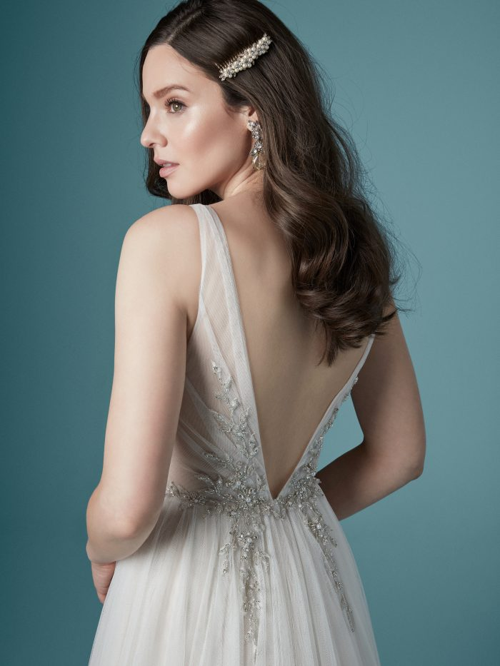 Model Wearing Romantic V-back Wedding Dress Called Meletta by Maggie Sottero