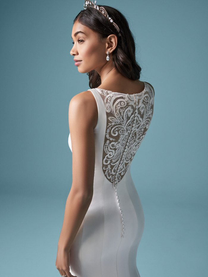 Model Wearing Dramatic Back Wedding Dress Called Nadia by Maggie Sottero