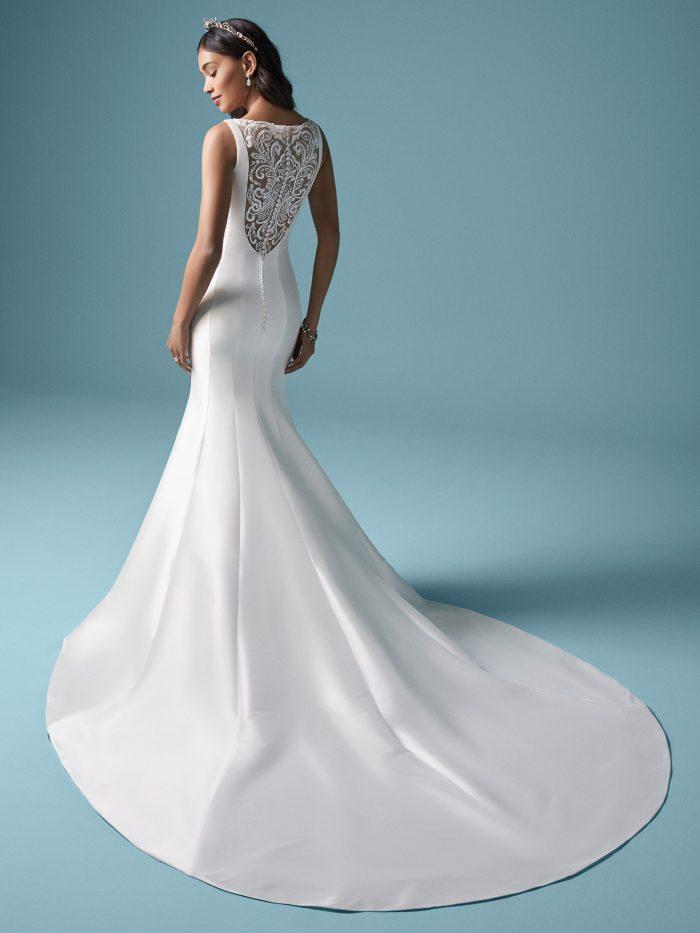 Model Wearing Dramatic Back Mermaid Wedding Dress Called Nadia by Maggie Sottero