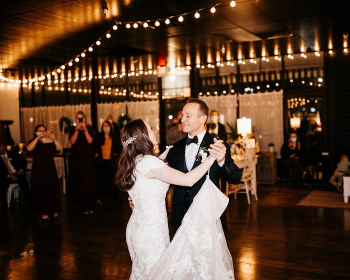 Father of Bride Dancing with Bride During Father-Daughter Dance at Rustic Wedding Reception