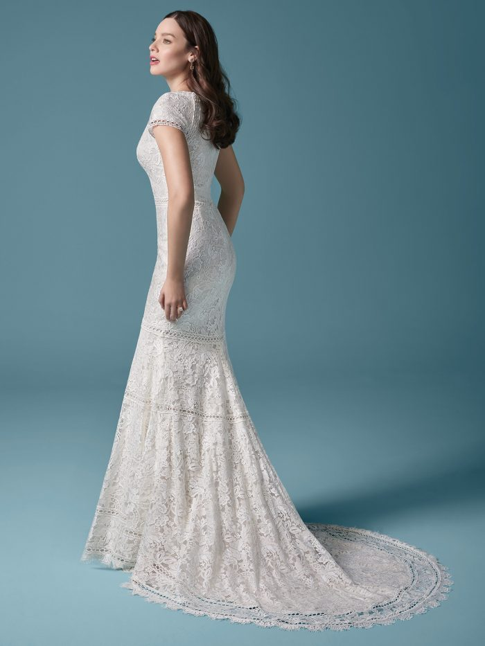 Bride Wearing Modest Vintage Fit-and-Flare Wedding Dress