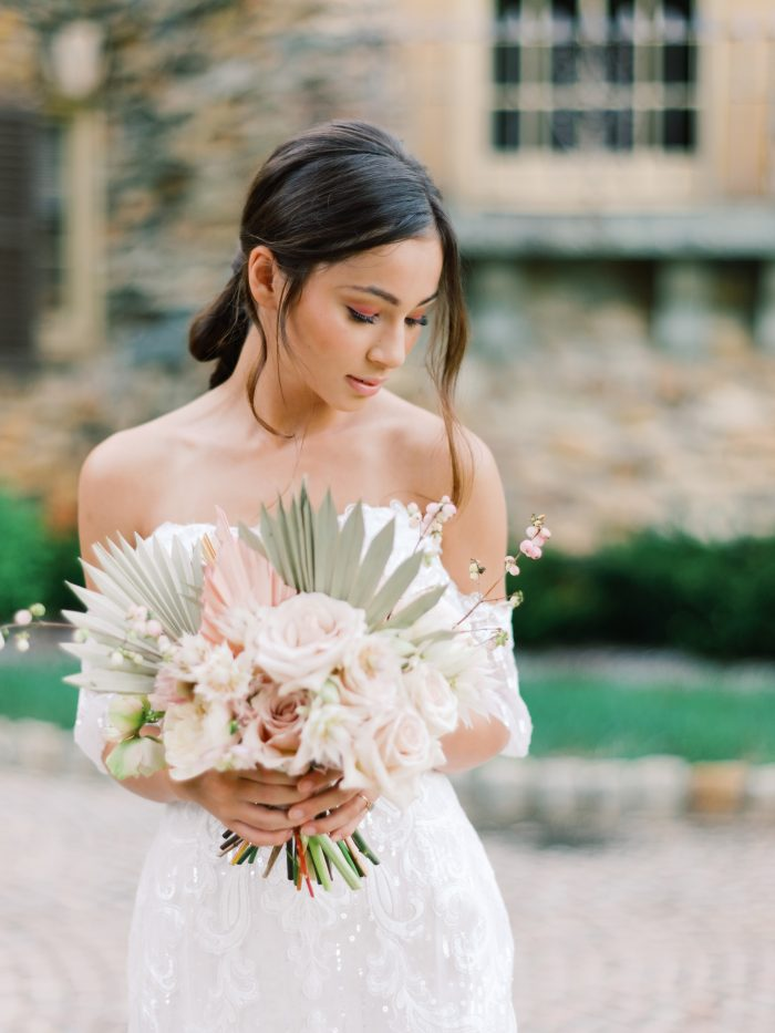 Real Bride Wearing Conrad Wedding Dress by Sottero and Midgley and Holding Modern Wedding Bouquet