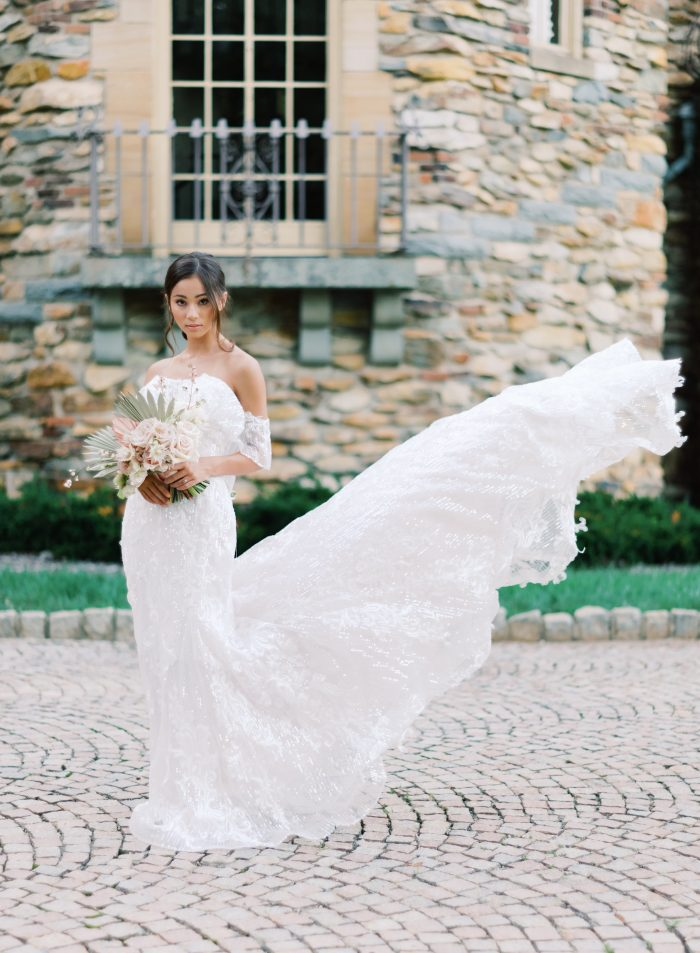 Bride Wearing Shimmery Off-the-Shoulder Bohemian Wedding Dress Called Conrad by Sottero and Midgley