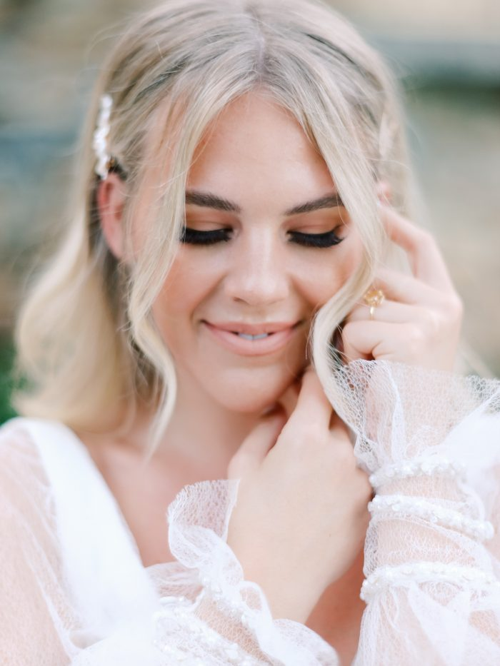 Model Wearing Bishop Sleeve Bohemian Wedding Dress Called Joanne by Rebecca Ingram