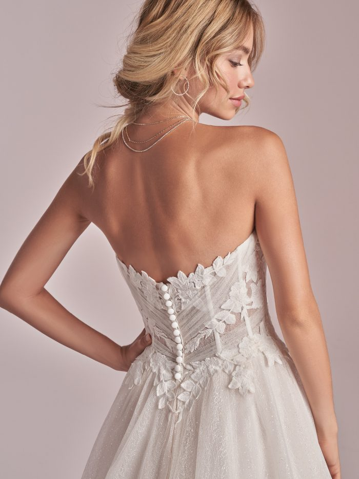 Model Wearing Affordable Strapless Princess Wedding Dress Called Remy by Rebecca Ingram
