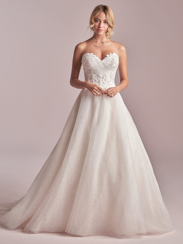 Model Wearing Maggie Sottero Wedding Dress Under $1000 Called Remy