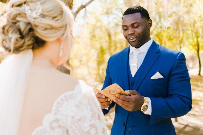 Groom Reading Vows to Real Bride Wearing Lace Ball Gown Wedding Dress Called Mallory Dawn by Maggie Sottero