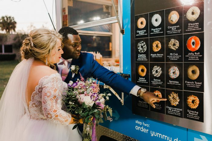Groom with Real Bride Ordering from Unique Donut Truck at Real Wedding
