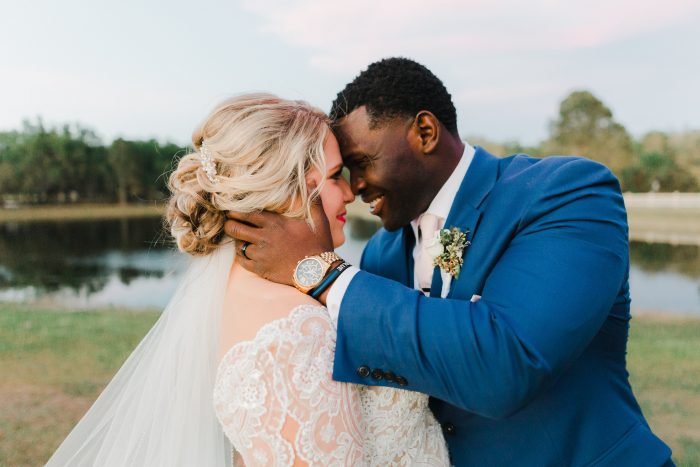 Groom Hugging Real Bride Wearing Lace Ball Gown Wedding Dress Called Mallory Dawn by Maggie Sottero