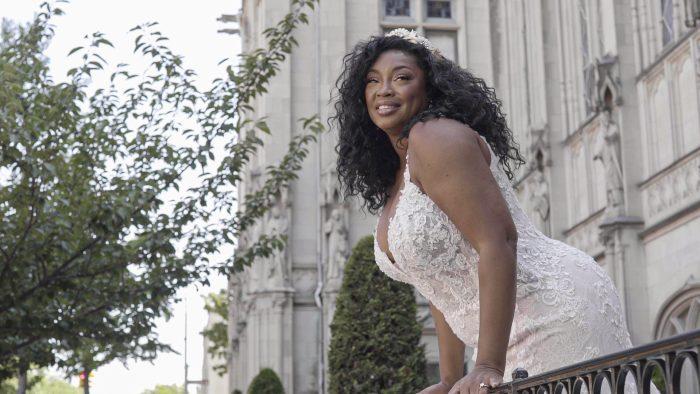 Black Plus Size Model Wearing Curvy Wedding Dress Called Farrah by Maggie Sottero