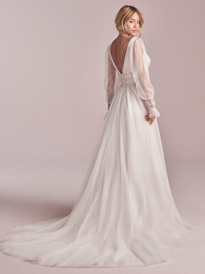 Model Wearing Sheer Bishop Sleeve Lightweight A-line Wedding Gown Called Joanne by Rebecca Ingram