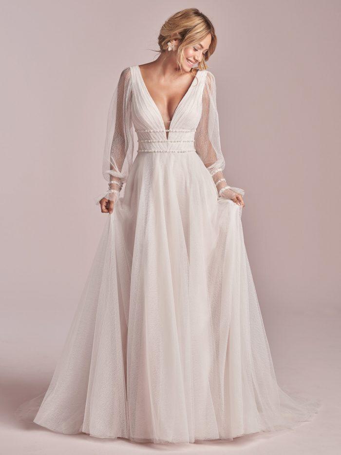 Model Wearing Sheer Bishop Sleeve A-line Wedding Dress Called Joanne by Rebecca Ingram