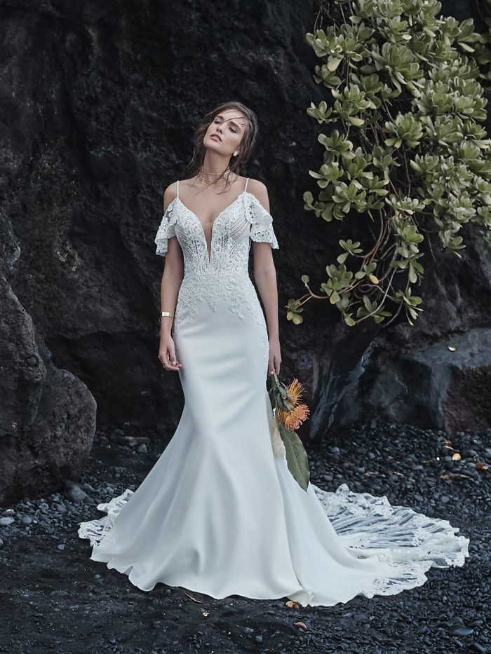 Bride on Beach Wearing Cold Shoulder Sleeve Sheath Wedding Dress Called Bracken Made by Sottero and Midgley
