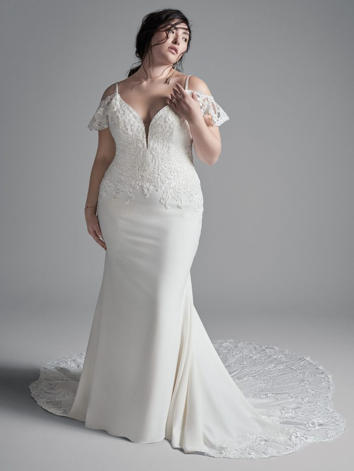 Curvy Model Wearing Plus Size Cold Shoulder Sleeve Wedding Dress Called Bracken Made by Sottero and Midgley