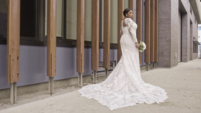 Black Model Wearing Plus Size Elegant Sheath Wedding Dress Called Hamilton Lynette by Sottero and Midgley