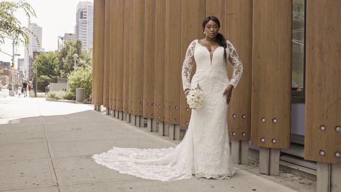 Plus Size Model Wearing Elegant Curvy Wedding Dress with Illusion Lace Sleeves Called Hamilton Lynette by Sottero and Midgley