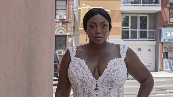Black Bride Looking at the Camera and Wearing Sweetheart Neck Mermaid Bridal Dress Called Joss by Sottero and Midgley