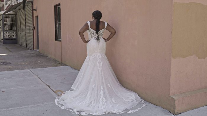 Black Model From Back Wearing Plus Size Mermaid Lace Wedding Gown Called Joss by Sottero and Midgley