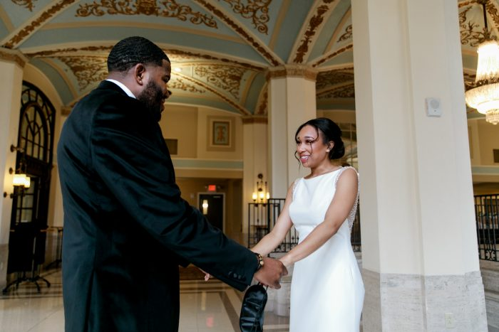 Groom with Real Bride During First Look in Formal Venue Called the Historic Onesto in Canton, Ohio