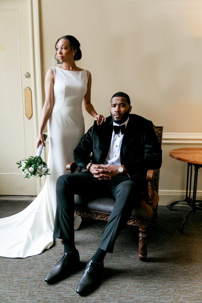 Groom Sitting with Bride in Ritzy and Classic Wedding Venue the Historic Onesto in Canton, Ohio