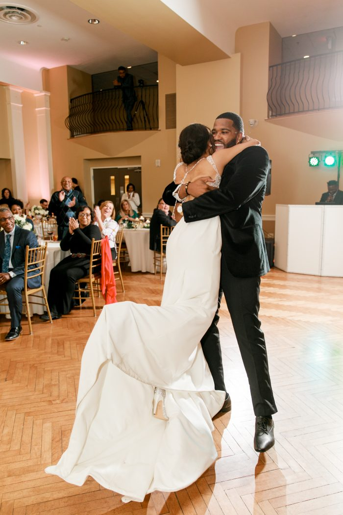 Real Bride and Groom Dancing at Elegant Wedding Reception Surrounded by Wedding Guests