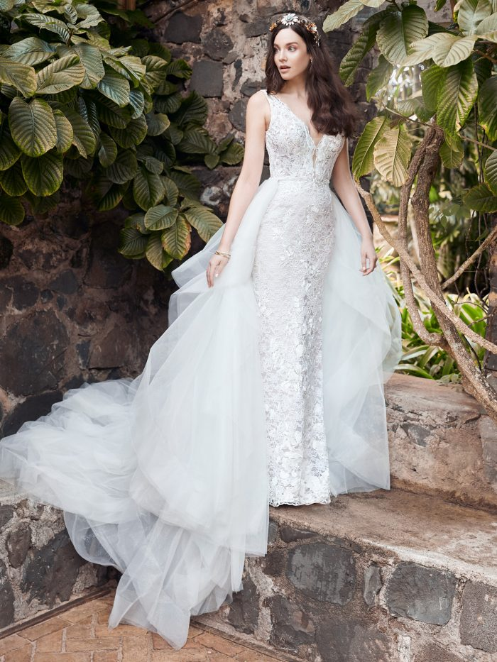 Model Wearing Square Back Lace Sheath Wedding Dress with Overskirt Called Callan by Maggie Sottero