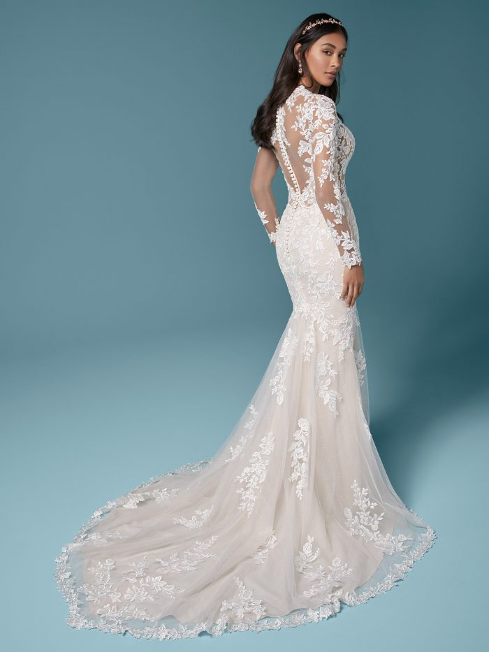 Model Wearing Illusion Lace Sleeve Sheath Bridal Gown Called Francesca by Maggie Sottero