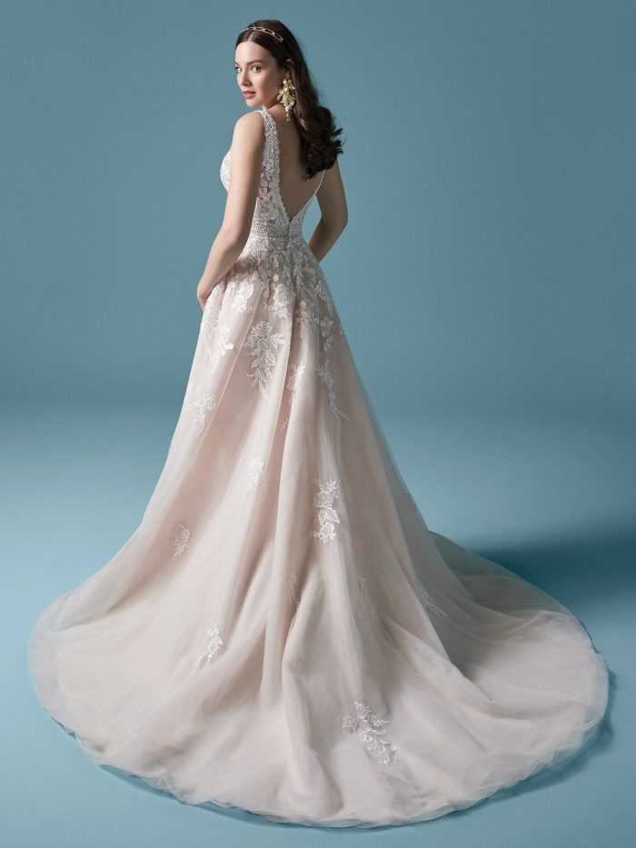 Model Wearing Romantic Lace A-line Wedding Dress Called Raphael Dawn by Maggie Sottero