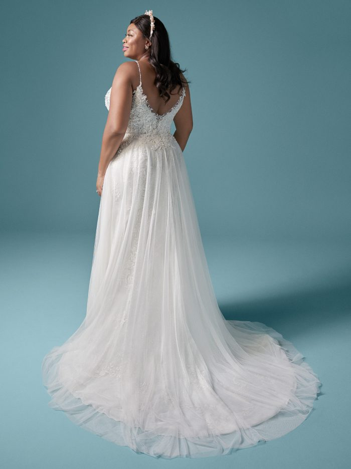 Plus Size Model Wearing Boho Tulle A-line Wedding Gown Called Roanne by Maggie Sottero