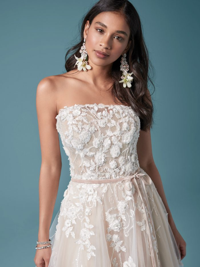 Model Wearing Colorful Strapless A-line Wedding Dress Called Zareen by Maggie Sottero
