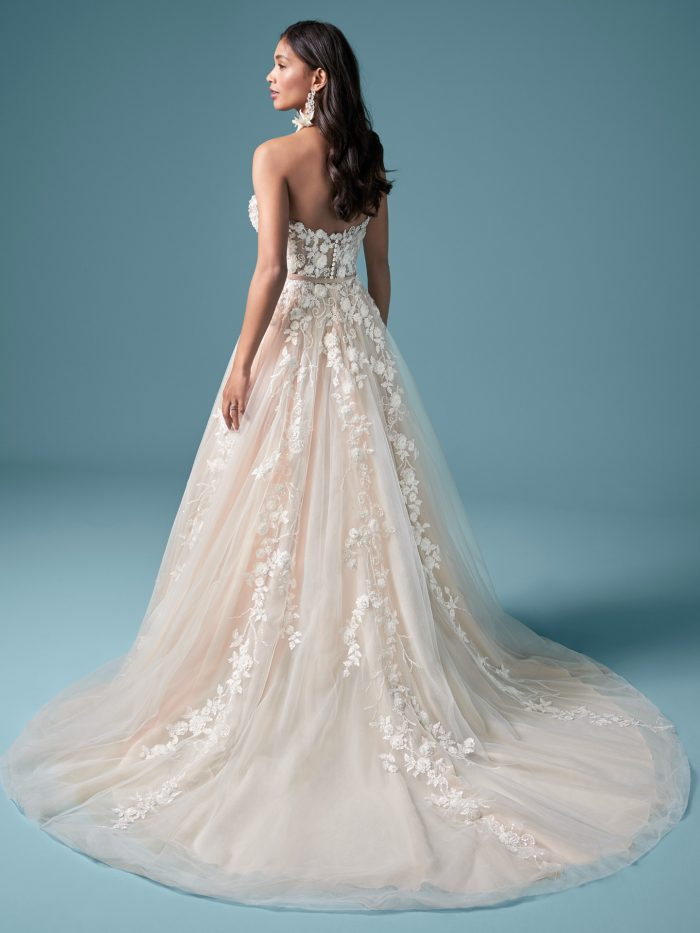 Model Wearing Floral Lace Strapless A-line Wedding Dress Called Zareen by Maggie Sottero