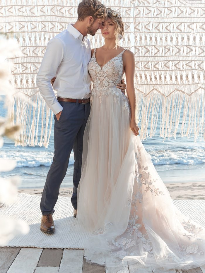 Groom with Bride Wearing Colorful Floral Lace A-line Wedding Dress Called Minerva by Rebecca Ingram