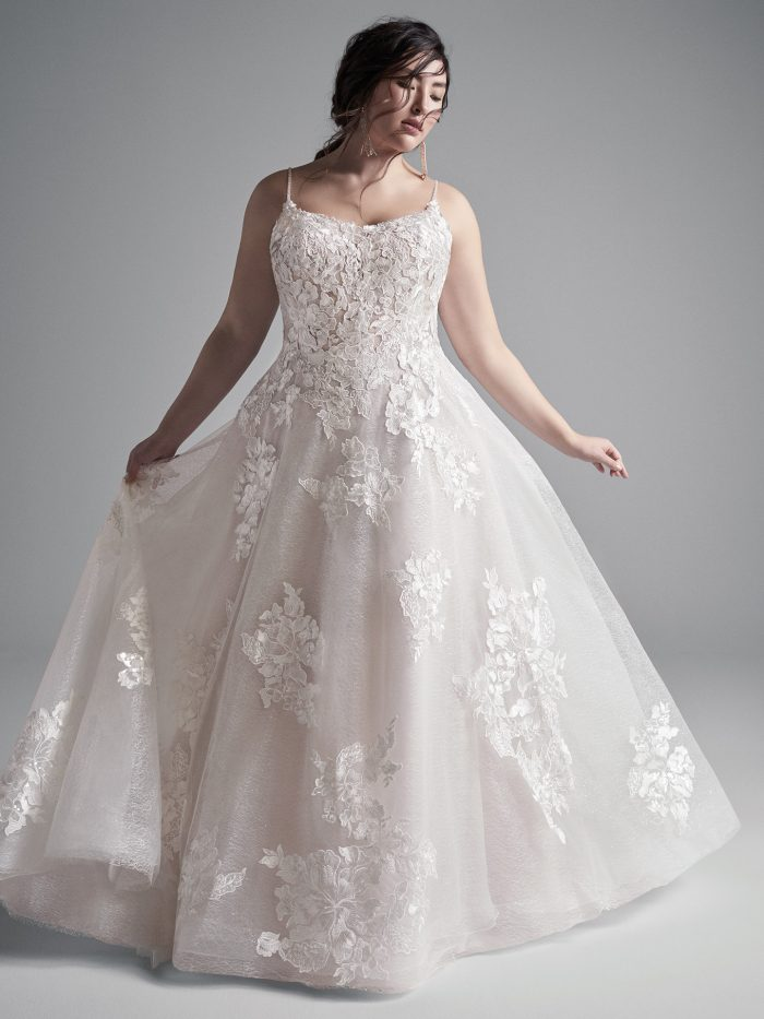 Plus Size Model Wearing Plus Size Floral Lace A-line Wedding Gown Called Houston by Sottero and Midgley