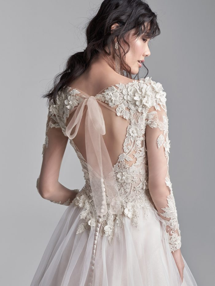Model Wearing Long Sleeve Keyhole Back Ball Gown Wedding Dress Called Mathias by Sottero and Midgley