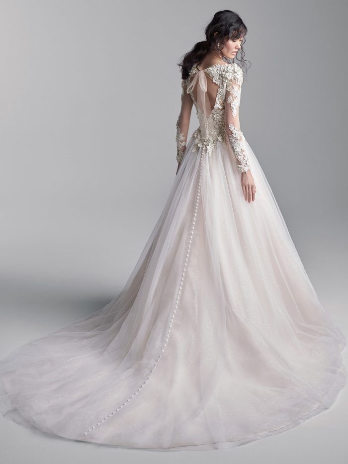 Model Wearing 3-D Lace Sleeve Keyhole Back Ball Gown Wedding Dress Called Mathias by Sottero and Midgley