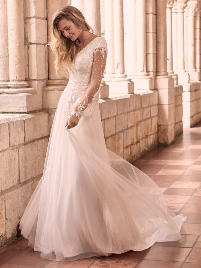 Bride Wearing Modest Bishop Sleeve Bridal Gown Called Pamela Leigh by Maggie Sottero