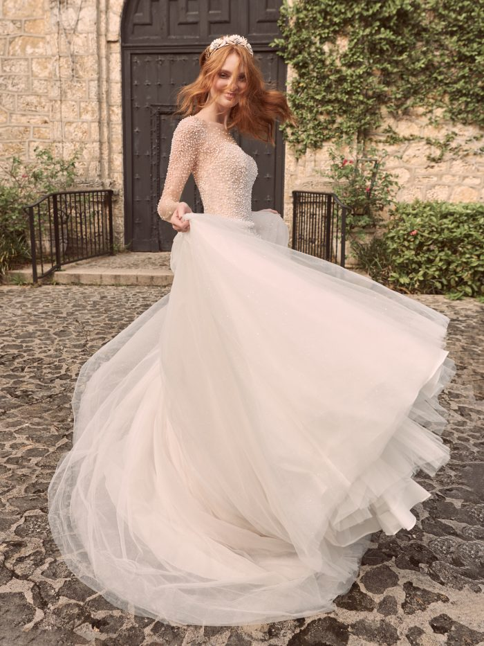 Model Wearing Long Sleeve Pearl Ball Gown Wedding Dress Called Rosette by Maggie Sottero