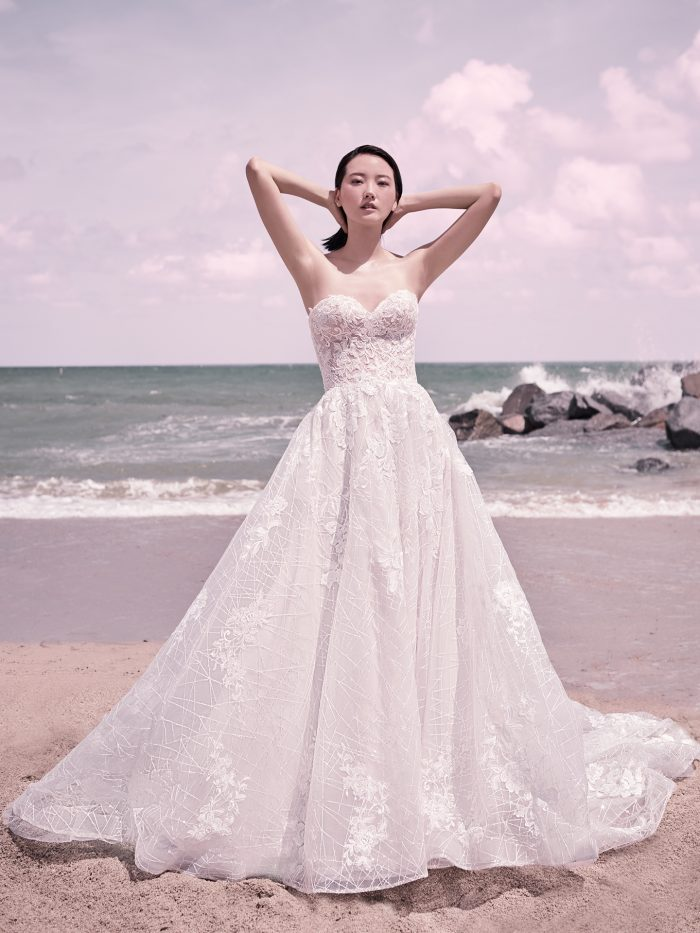 Model Wearing Strapless Princess Wedding Dress Called Parker by Sottero and Midgley