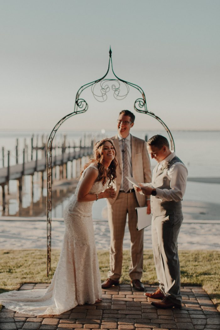 Bride and Groom on Beach Getting Married in Front of Friends and Family