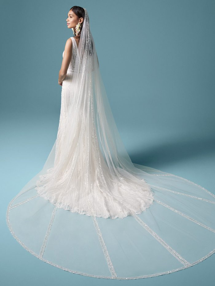 Model Wearing Lace V-neck Wedding Dress with Lace Vintage Wedding Veil Called Coretta by Maggie Sottero