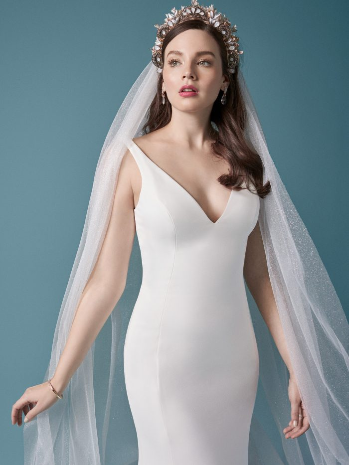 Model Wearing Minimalist Crepe Wedding Gown with Simple Tulle Veil Called Fernanda by Maggie Sottero
