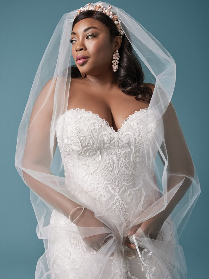 Plus Size Model Wearing Embroidered Lace Mermaid Wedding Dress and Vintage Wedding Veil Called Milena by Maggie Sottero